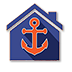 Blue house with orange Anchor Realty of the Gulf Coast logo.