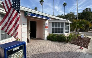 American flag outfront of Anchor Realty of the Gulf Coast.