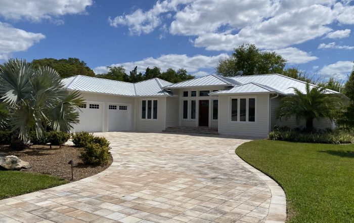 Selling a home in Florida with trees in front.